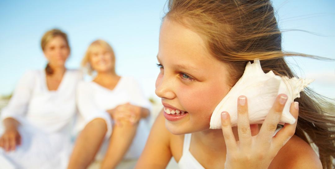 girl_listening_shell_children_hearing